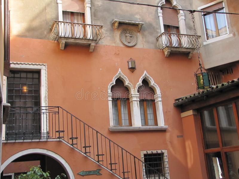 Italian architectural styles on display in Venice. Venice,Italy`s building`s have beautiful stone staircases, statues, murals, windows and other features, that stock image