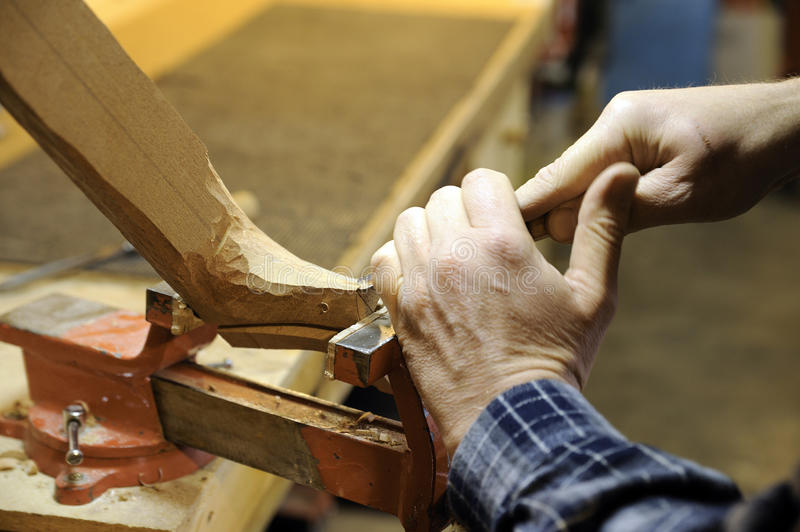 Italian artisan luthier wood carver. Hands of an artisan Italian luthier wood carver at work stock photos
