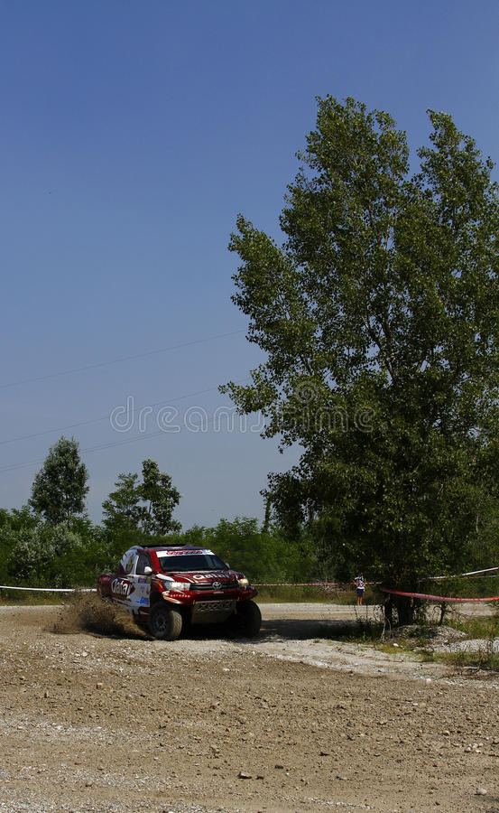 Italian Baja 2016. Full gas out of a turn for Al Attiya and Baumel on Toyota Hilux 4wd at Italian Baja 2016 stock images