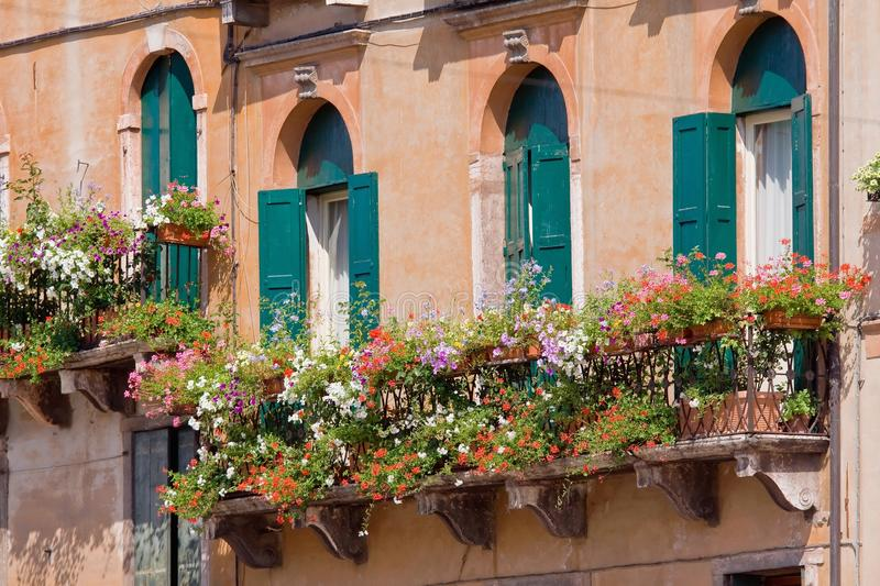 Download Italian Balcony With Flowerpots And Flowers Stock Photo - Image: 10498886