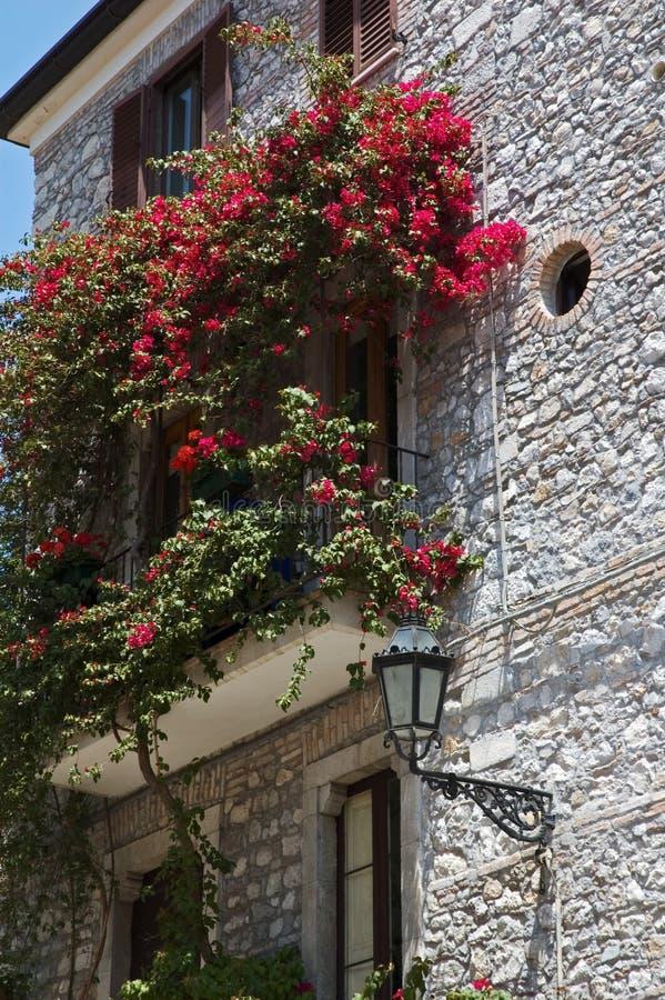 Italian balcony with flowers royalty free stock photography
