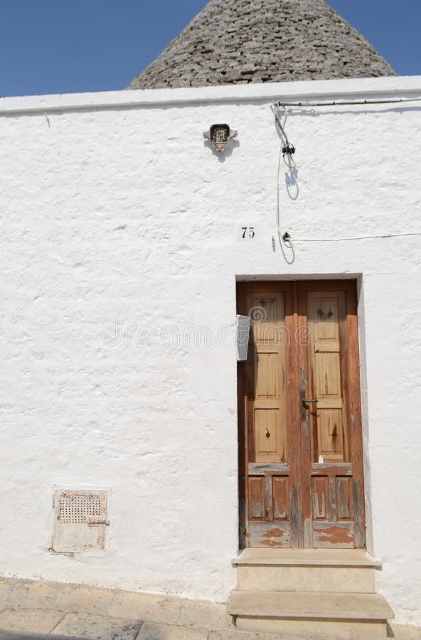 Old front door in Alberobello - Apulia Italy royalty free stock photography