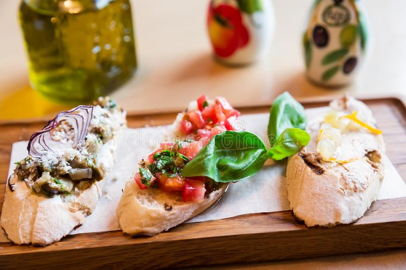Italian bruschetta with roasted tomatoes, mozzarella cheese royalty free stock photography