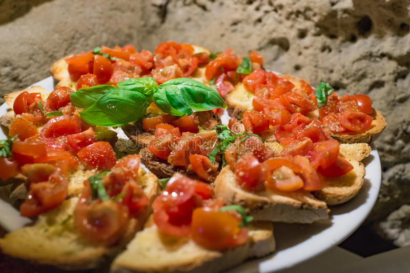 Italian bruschettas with chopped tomato and basil ready for breakfast stock images
