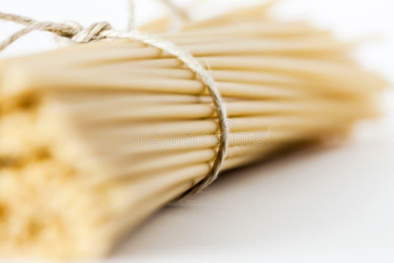 Italian bucatini pasta on white surface stock photo