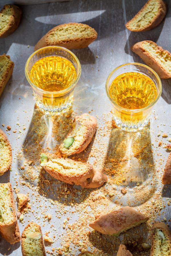 Italian cantucci with pistachios and Vin Santo wine. On old table royalty free stock photos