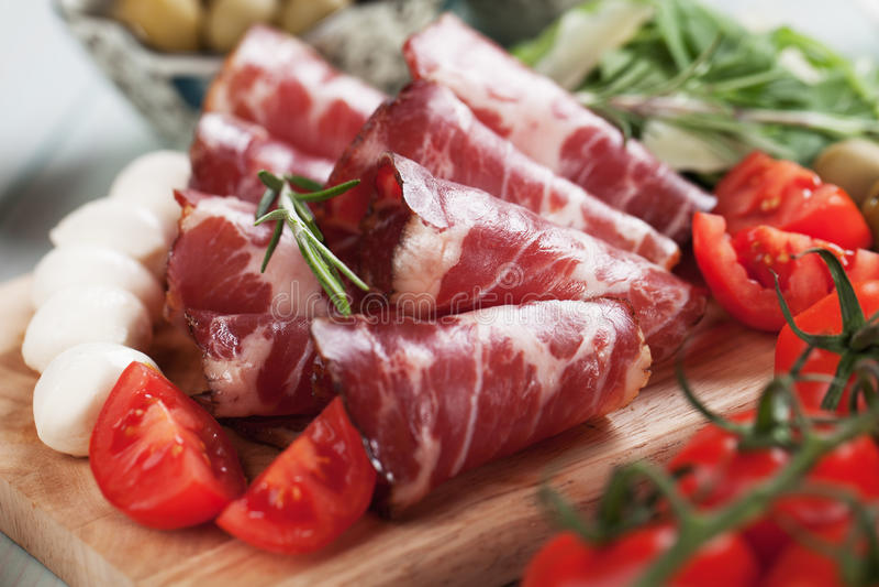Italian capocollo, cured pork meat. Slices of capocollo or capicola, italian cured and aged pork meat stock photo