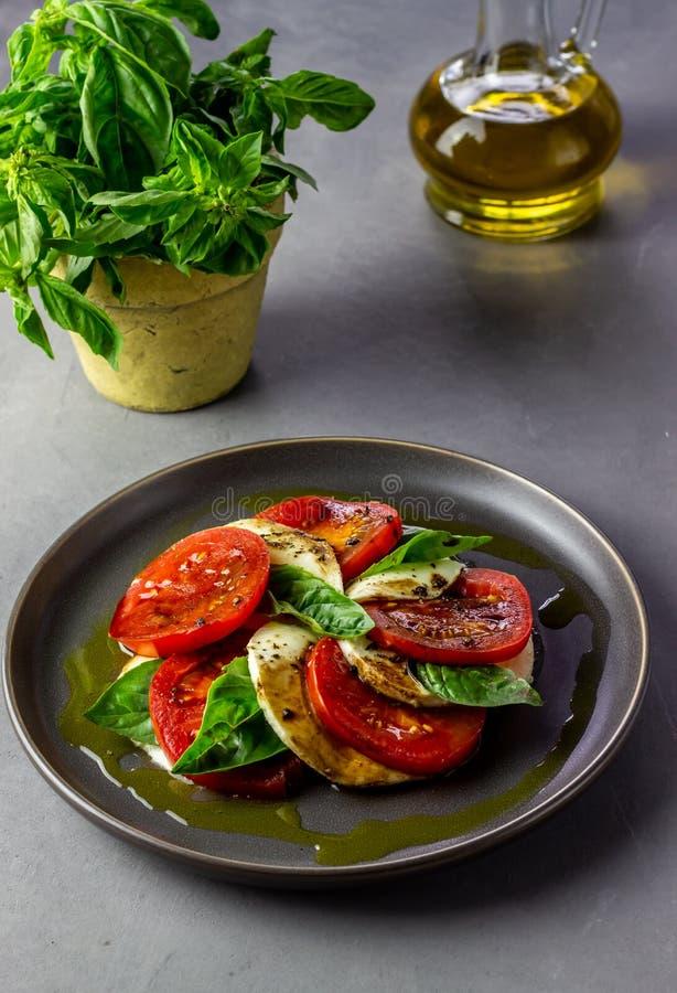 Italian caprese salad with mozzarella and tomatoes. Concrete background. Healthy food. stock photos