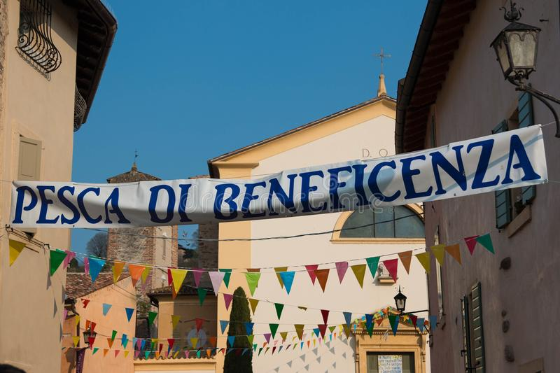Italian charity raffle banner in charming village stock image