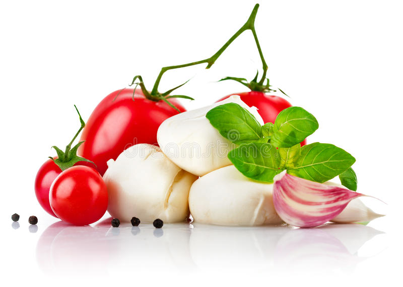 Italian cheese mozzarella with tomato and basil. On white background royalty free stock image