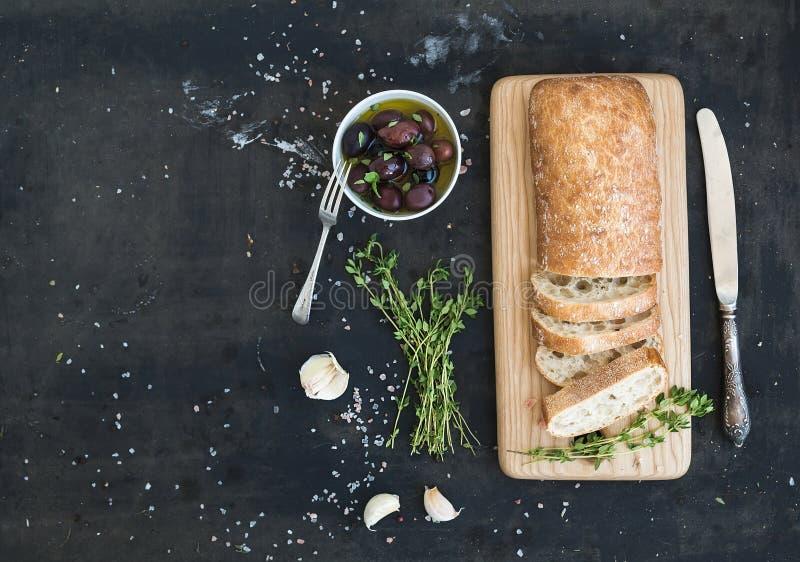 Italian ciabatta bread cut in slices on wooden stock image
