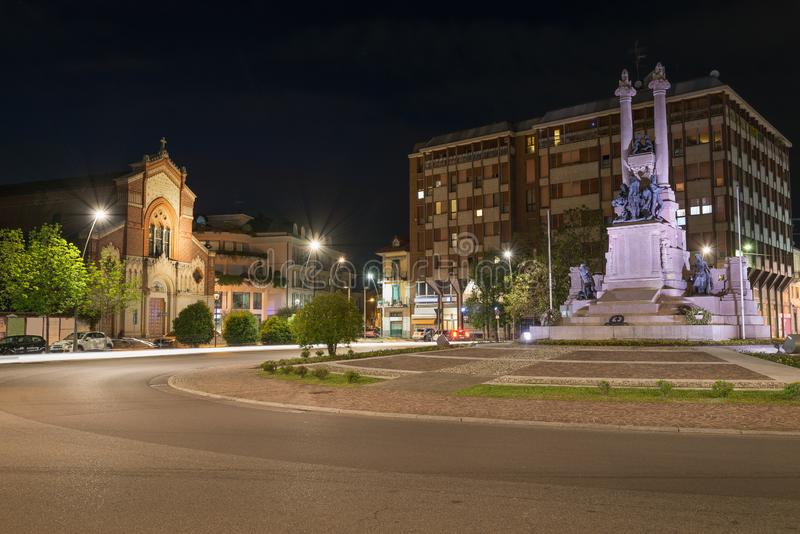 Italian city at night, art and culture. Gallarate, square Risorgimento royalty free stock images