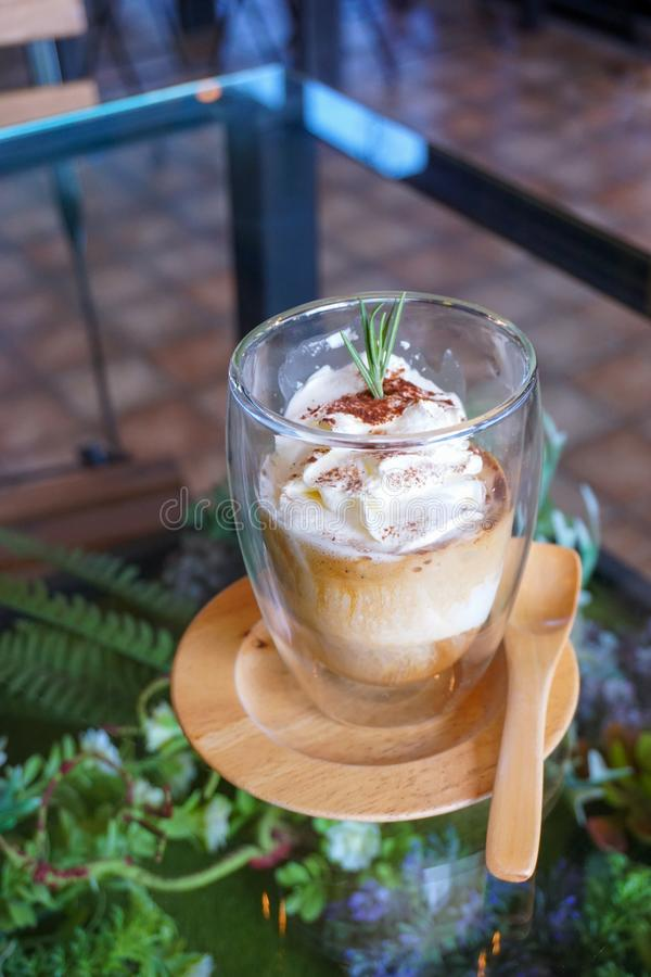 Italian coffee-based dessert, Pouring shots of hot espresso on vanilla ice cream to make an affogato coffee. A glass of coffee in royalty free stock photography