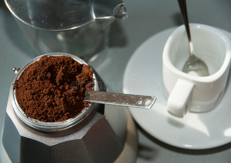 Italian coffee with ground coffee and a cup stock photo