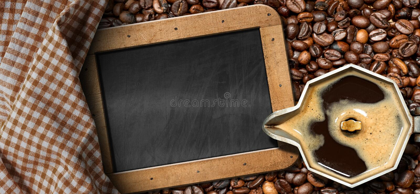 Italian Coffee Maker with Coffee Beans. Old italian coffee maker moka pot - top view with roasted coffee beans on the background and an empty blackboard with royalty free stock image