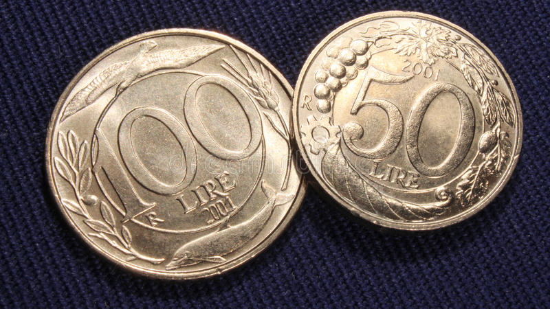 Italian coins 100 and 50 lire. Old italian lire coins, 50 and 100 lire, in nickel metal stock image