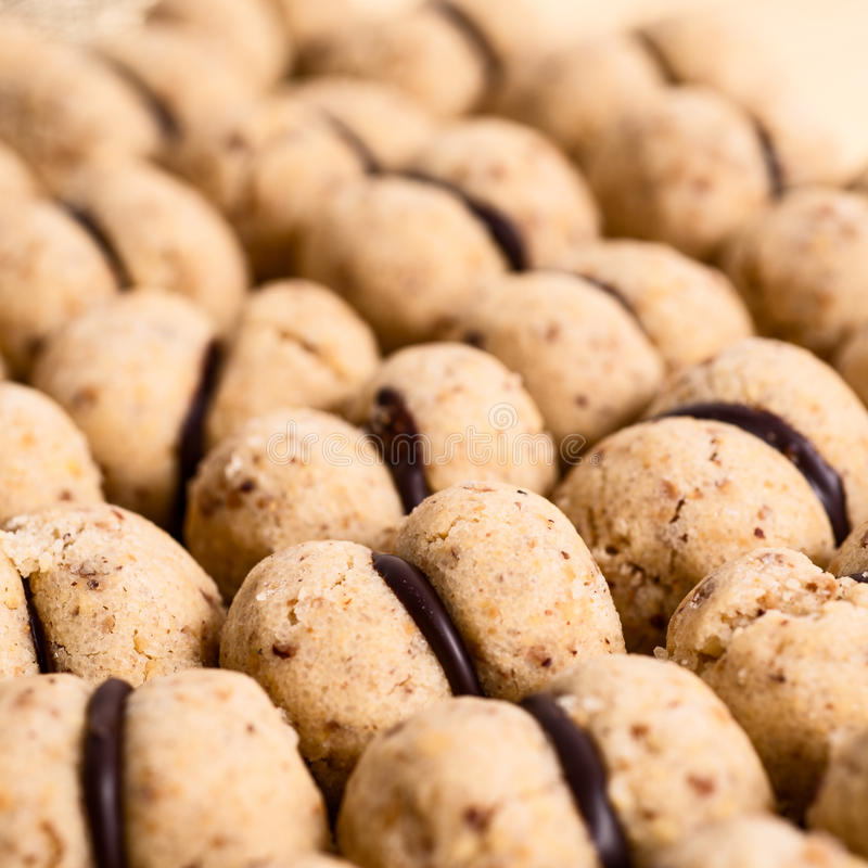 Italian cookies called baci di dama made with nuts. Italian fresh cookies called baci di dama made with nuts royalty free stock images