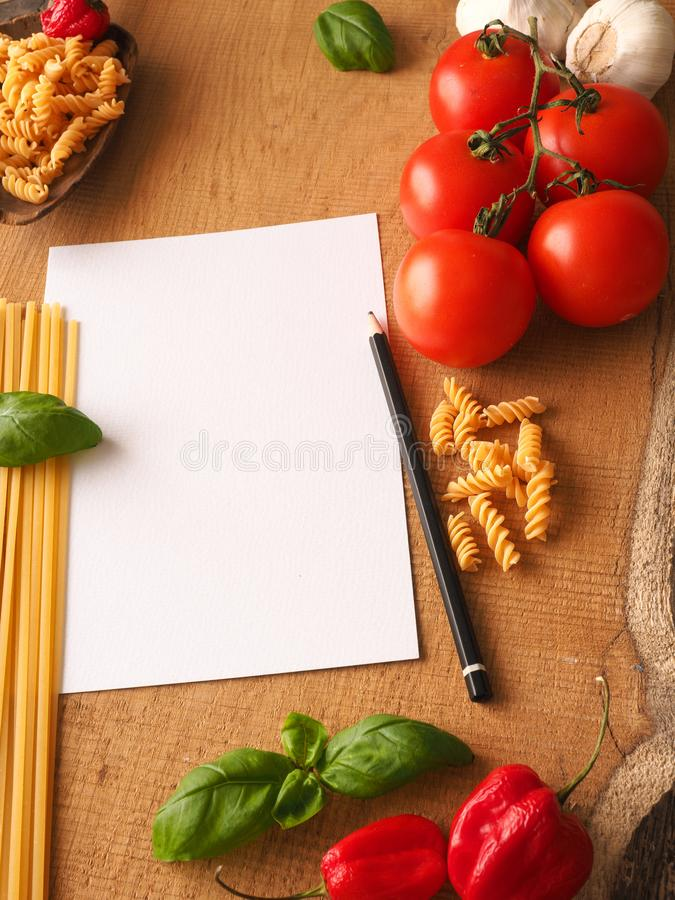 Italian cooking ingredients on a wooden table stock photo