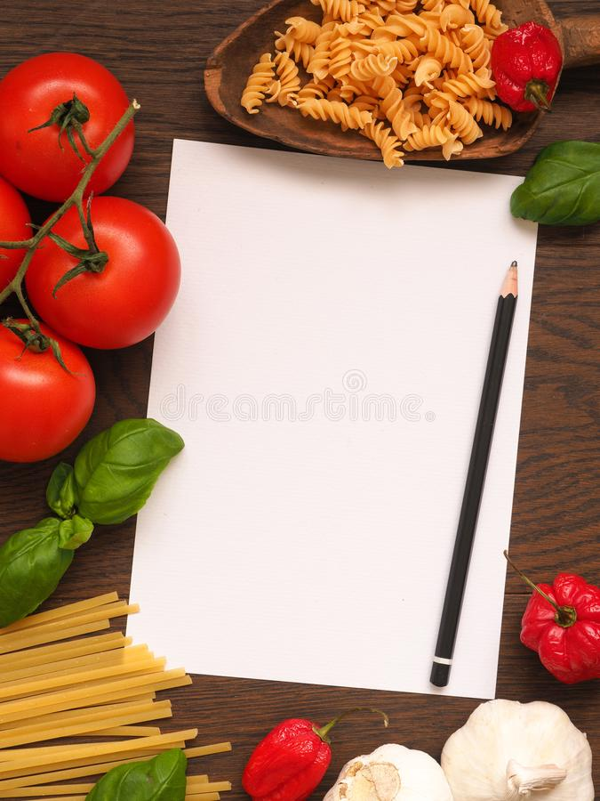 Italian cooking ingredients on a wooden table stock photography