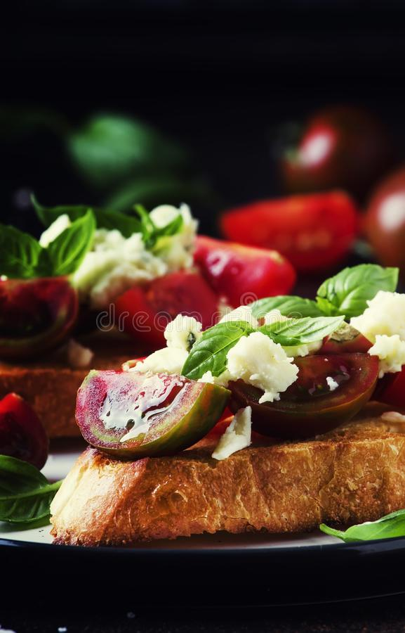 Italian crispy toasted bruschetta with black and brown cherry to royalty free stock images