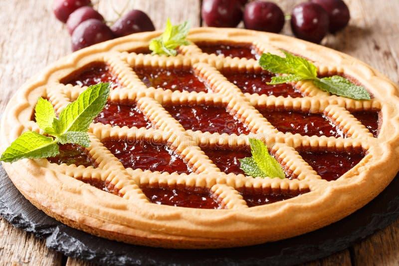 Italian crostata shortbread cake with cherries and mint closeup. stock photo