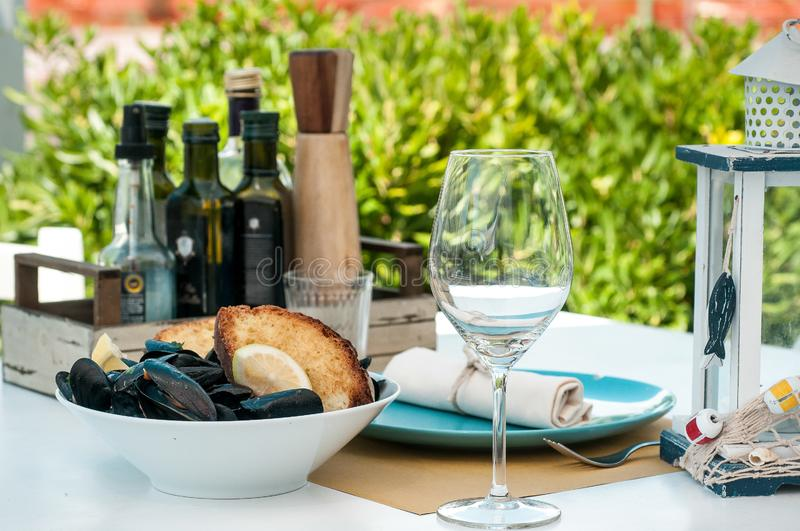 Black mussels with crispy bread on a plate royalty free stock photos