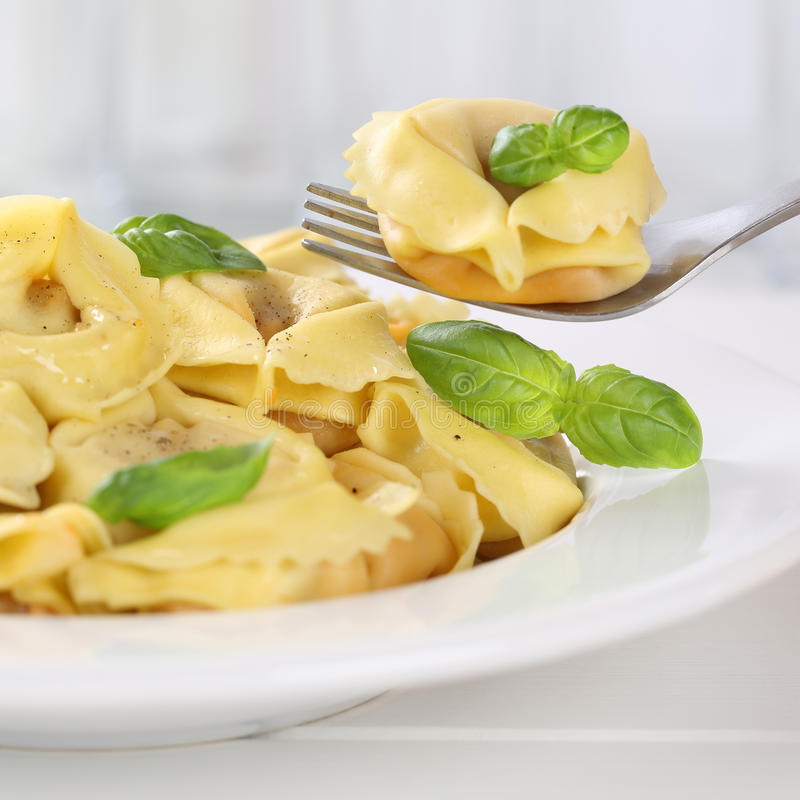 Italian cuisine eating tortellini pasta noodles meal with basil stock photography