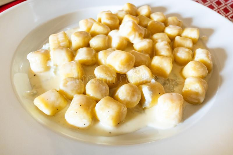 Italian cuisine - gnocchi with Gorgonzola stock photos