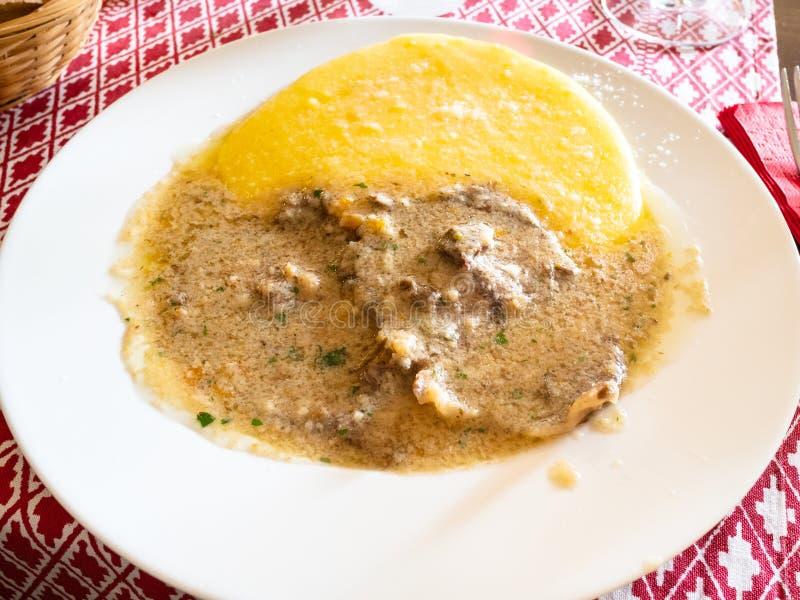 Italian cuisine - Manzo all 'Olio with polenta royalty free stock image