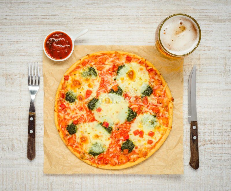 Italian Cuisine Pizza with Beer and Tomato Sauce stock photo