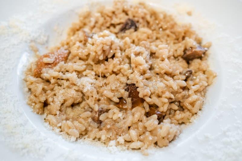 Italian cuisine - risotto con funghi porcini royalty free stock photo