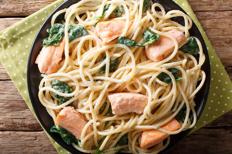 Italian cuisine: spaghetti with salmon, cream cheese and spinach royalty free stock images