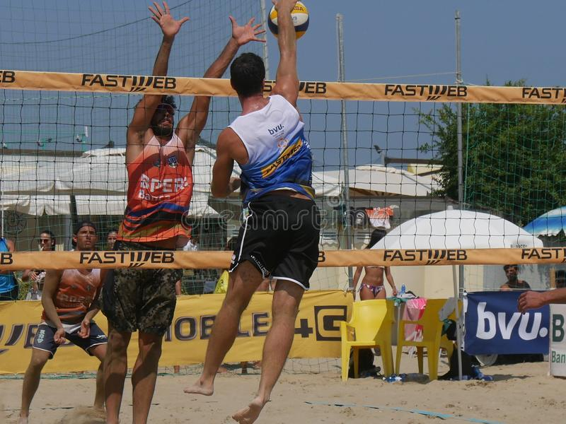 Italian Cup Beach Volley 2018 - Men Qualification. Male athletes playing in qualification Beach Volley match - FIPAV Beach Volley Italian Championship 2018 stock photography