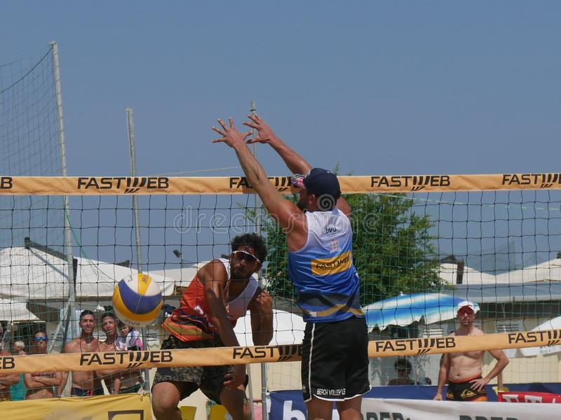 Italian Cup Beach Volley 2018 - Men Qualification. Male athletes playing in qualification Beach Volley match - FIPAV Beach Volley Italian Championship 2018 stock photo