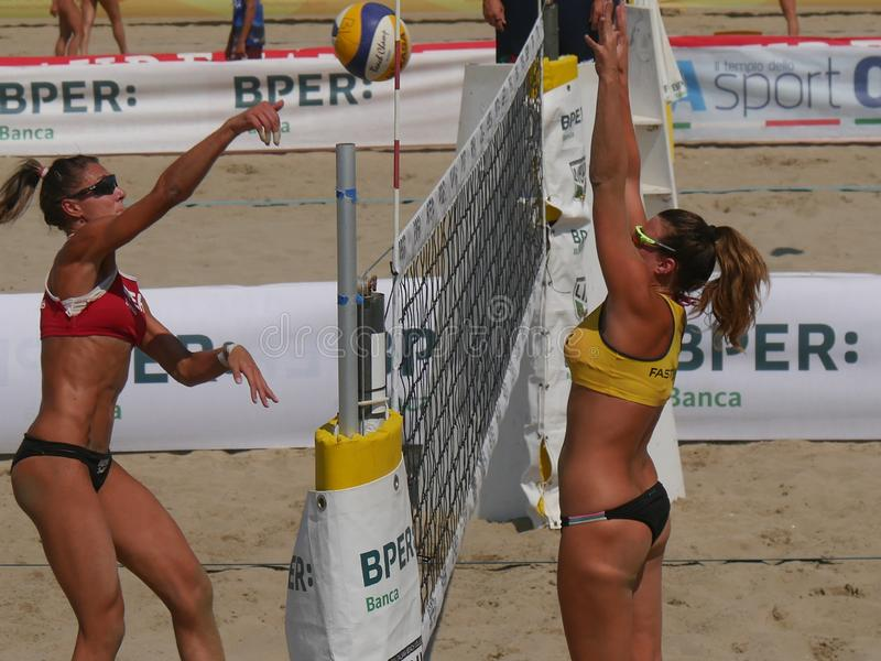 Italian Cup Beach Volley 2018 - Women Qualification. Female athletes playing in qualification Beach Volley match. FIPAV Beach Volley Italian Championship 2018 royalty free stock photo