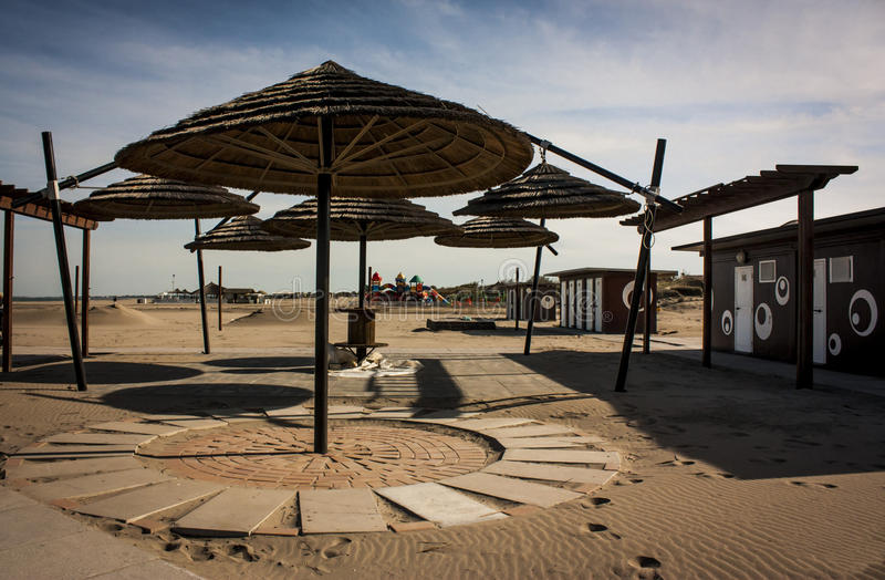 A Italian desert beach resort. Bathing establishment the desert in the winter off-season. Everything seems abandoned and lost to himself stock images