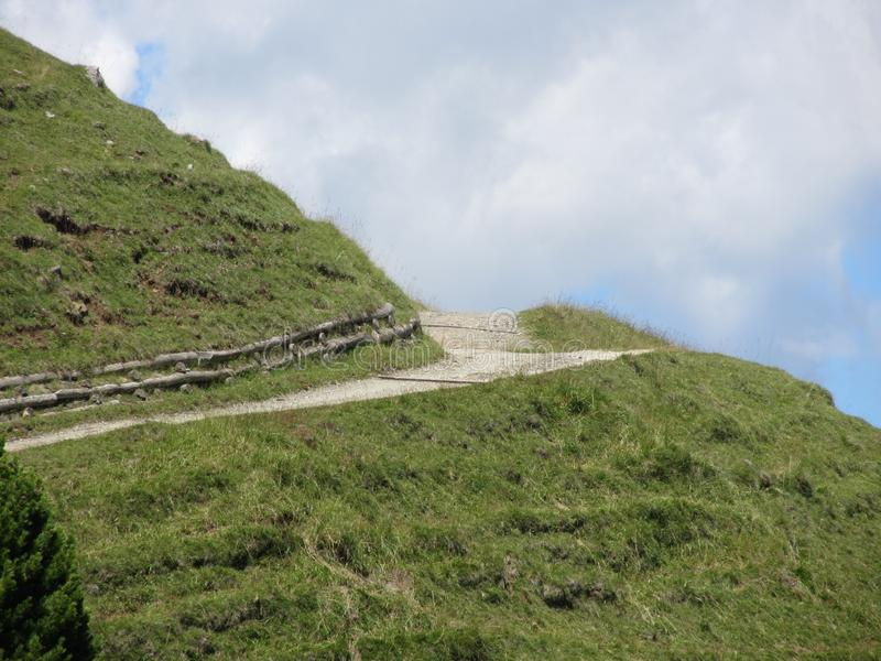 Italian Dolomites mountains landscape with upward hiking trail towards the sky . South tyrol, Italy.  stock photo