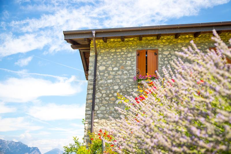 Italian finca, beautiful scenery with lavender blooms and blue sky. Italy house appartement garden season summer clouds blossoms holiday vacation village france stock photo