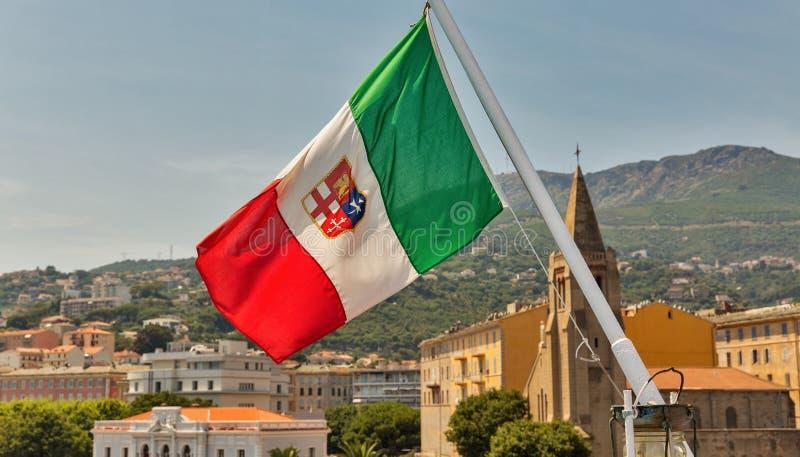 Italian flag with Bastia cityscape. Corsica, France stock image