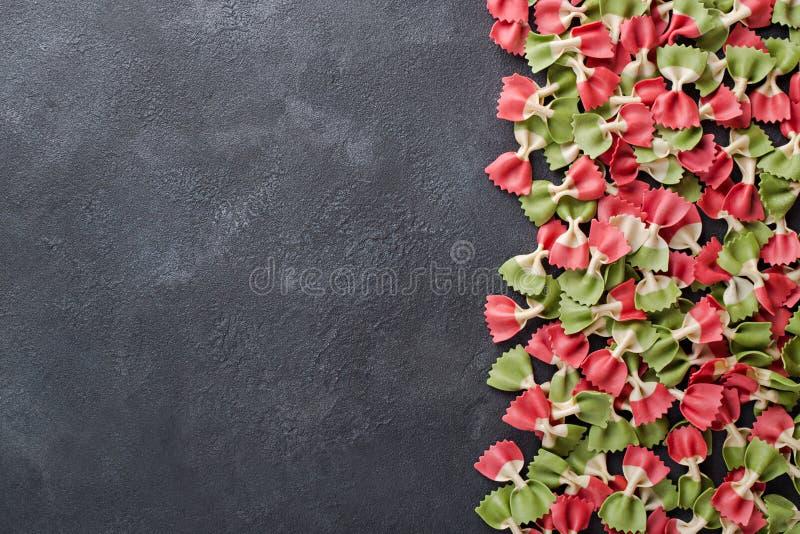 Italian flag farfalle pasta on dark background with copy space left horizontal stock photography