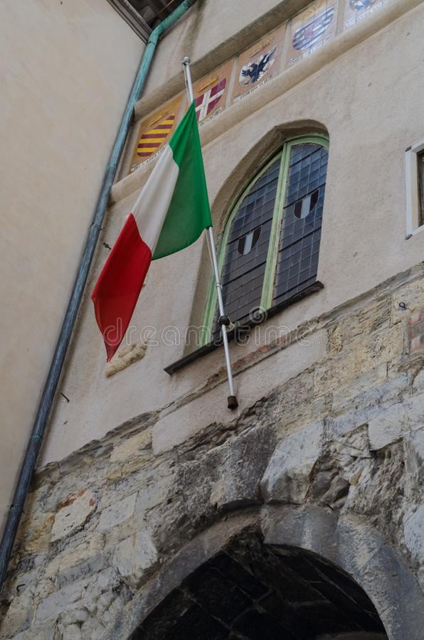 The Italian flag flying on a historic building in Savona. With its characteristic national colors green, white and red royalty free stock photo