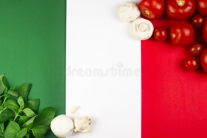 Italian flag with food. On Italian flag are Italian food ingredients: basil, tomato, garlic, mushroom stock photography