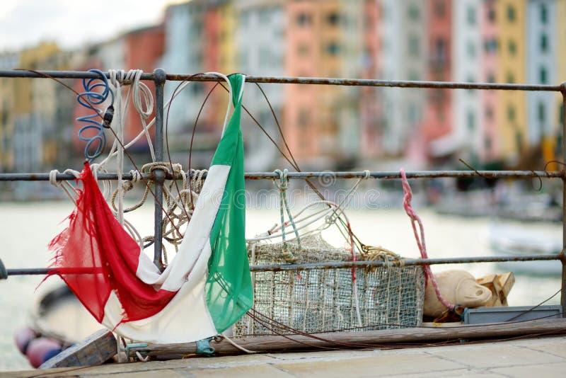 Italian flag in marina of Porto Venere town, a part of the Italian Riviera, Italy. Italian flag in marina of Porto Venere town, located in the province of La stock images