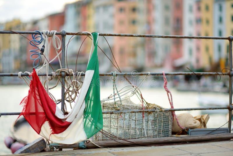 Italian flag in marina of Porto Venere town, a part of the Italian Riviera, Italy. Italian flag in marina of Porto Venere town, located in the province of La stock photography