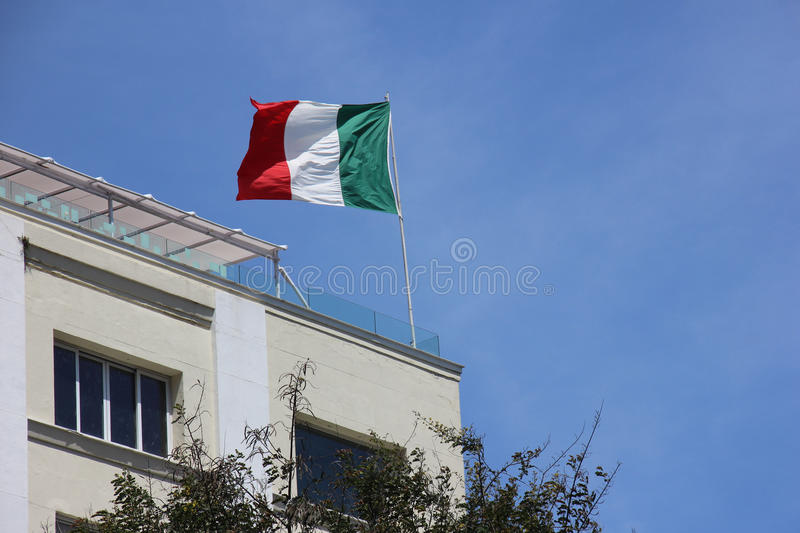 Italian Flag. In top of a building in Rio de Janeiro Downtown, in Brazil royalty free stock image