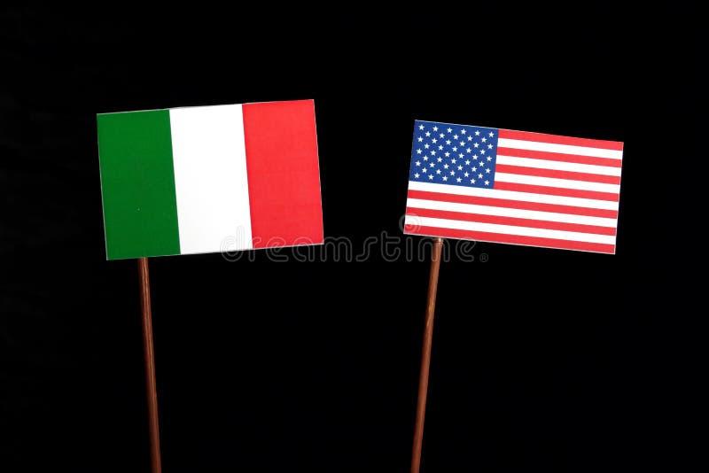 Italian flag with USA flag on black. Background royalty free stock image