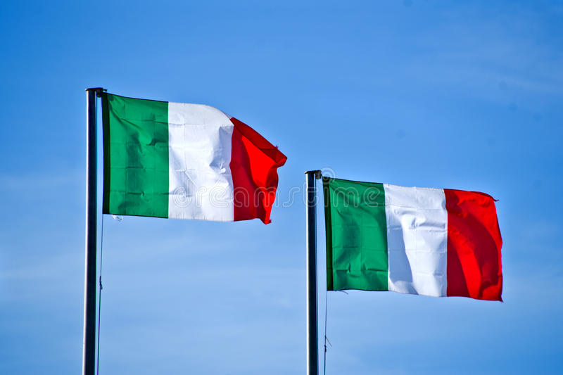 Italian flags. In the blue sky royalty free stock photos