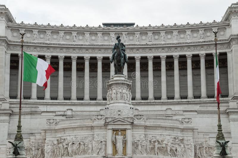 Italian flags and facade of Vittoriano monument or also known as Altare della Patria, symbol of Italian union, Rome, Italy stock photography