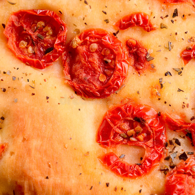 Italian focaccia with little tomatoes royalty free stock photo