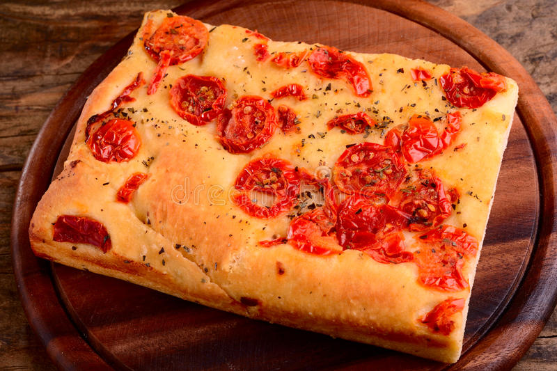 Italian focaccia with little tomatoes stock photo